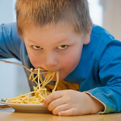 A child eating pasta